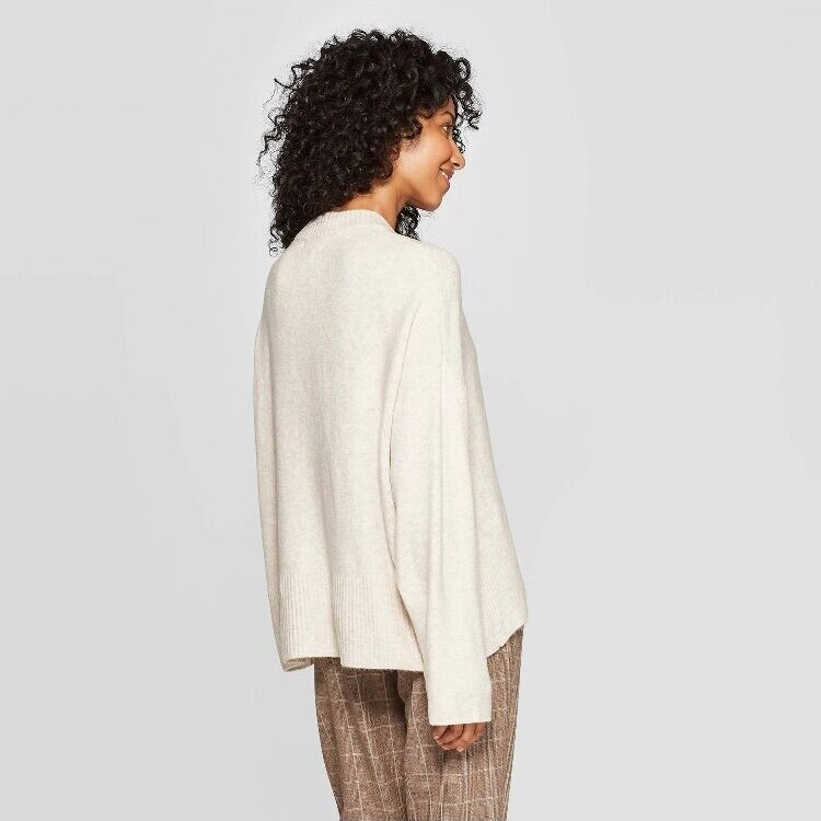 - Longer in the back to wear with leggings and comes in great colors! So comfy and I will be wearing this one A LOT this fall and winter.Find it here.