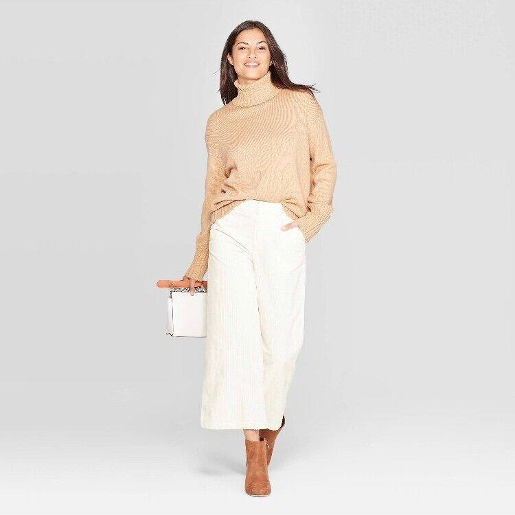 - Another great sweater. Long enough for leggings! Comes in an array of colors too!Find it here.