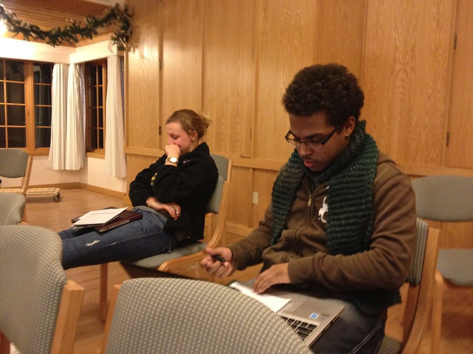 Students, Sarah and Phillip concentrating on what plays to vote for.