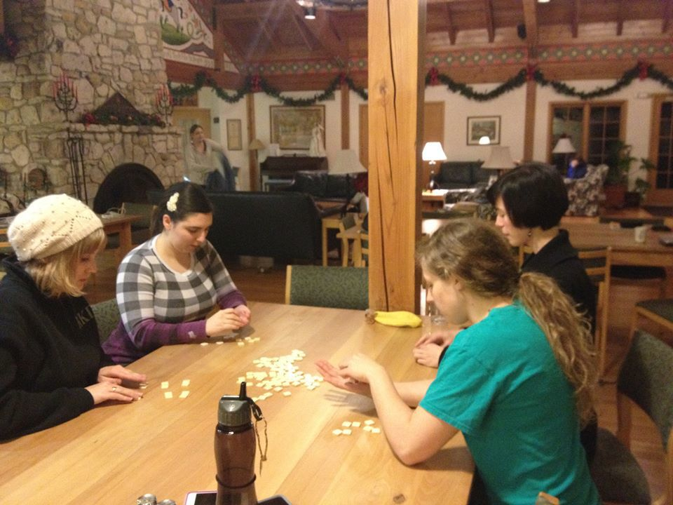 Some students taking a break playing a good, old classic game of Bananagrams.