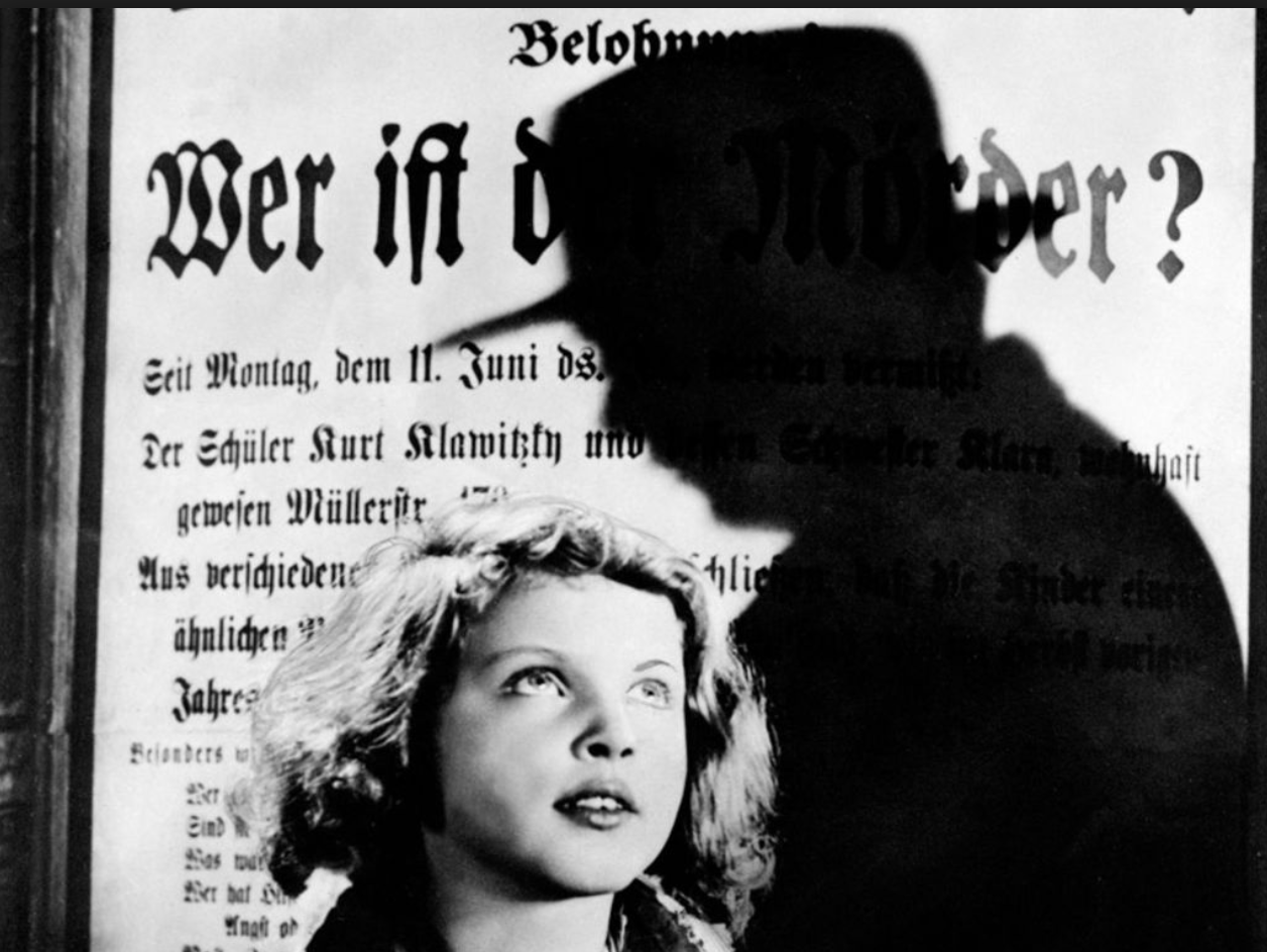 Visual references are made to Fritz Lang and Alfred Hitchcock, including this frame from Fritz Lang's 1931 work of German Expressionism, ' M ,'directly referenced in my last frame.