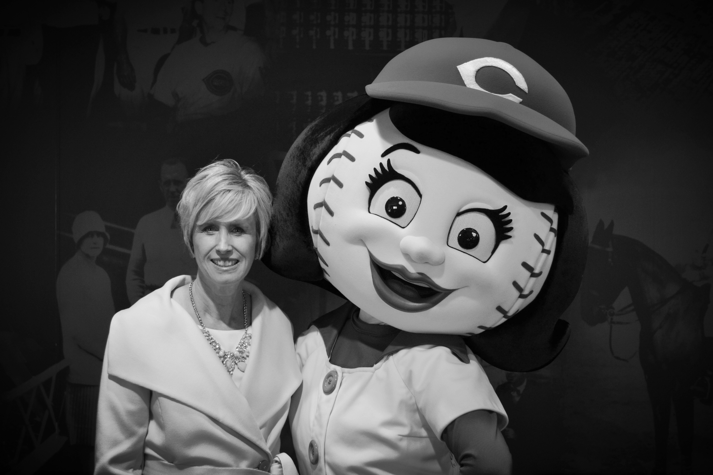 Tiffany Adams presents CELI's training programs to the Cincinnati Reds' wives and meets the lovely Rosie Red.