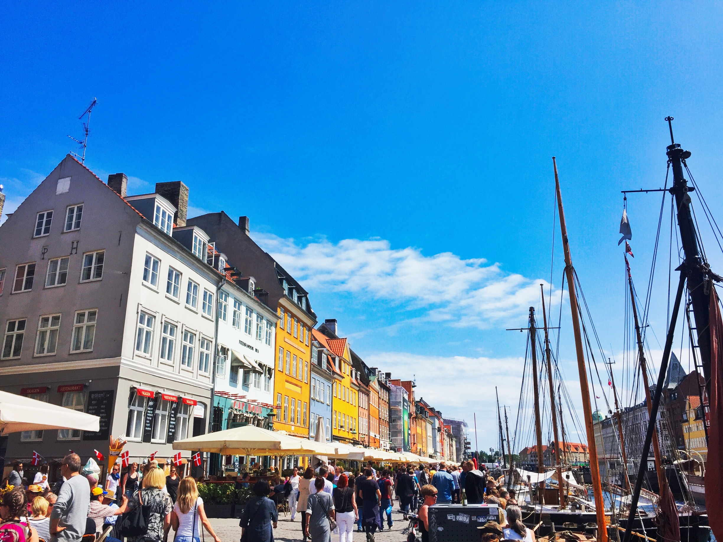 Picturesque Nyhavn. On a warm day, nothing beats sitting here with a Somersby or ice cream in hand.