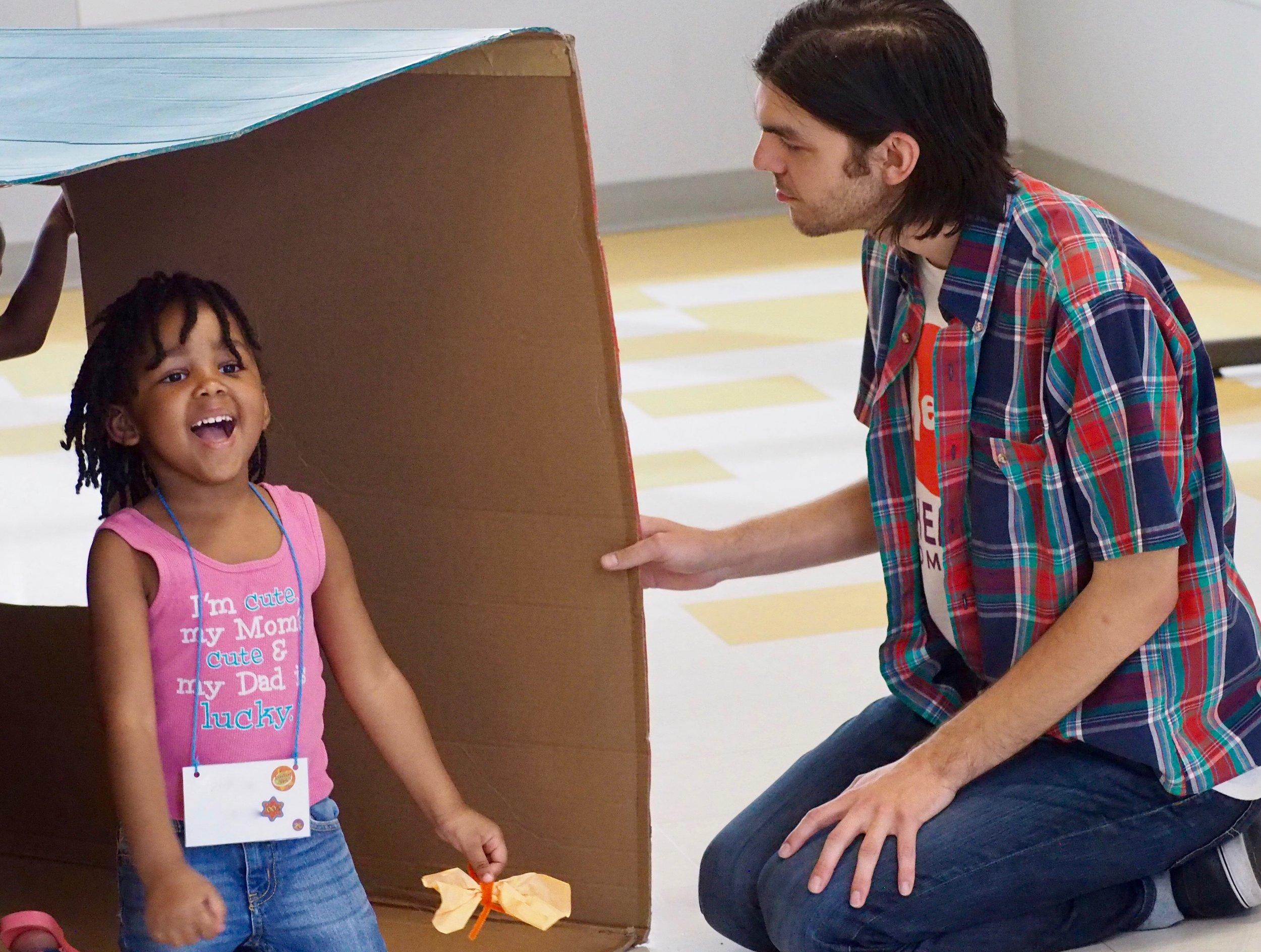 Girl and Josh in box.jpg