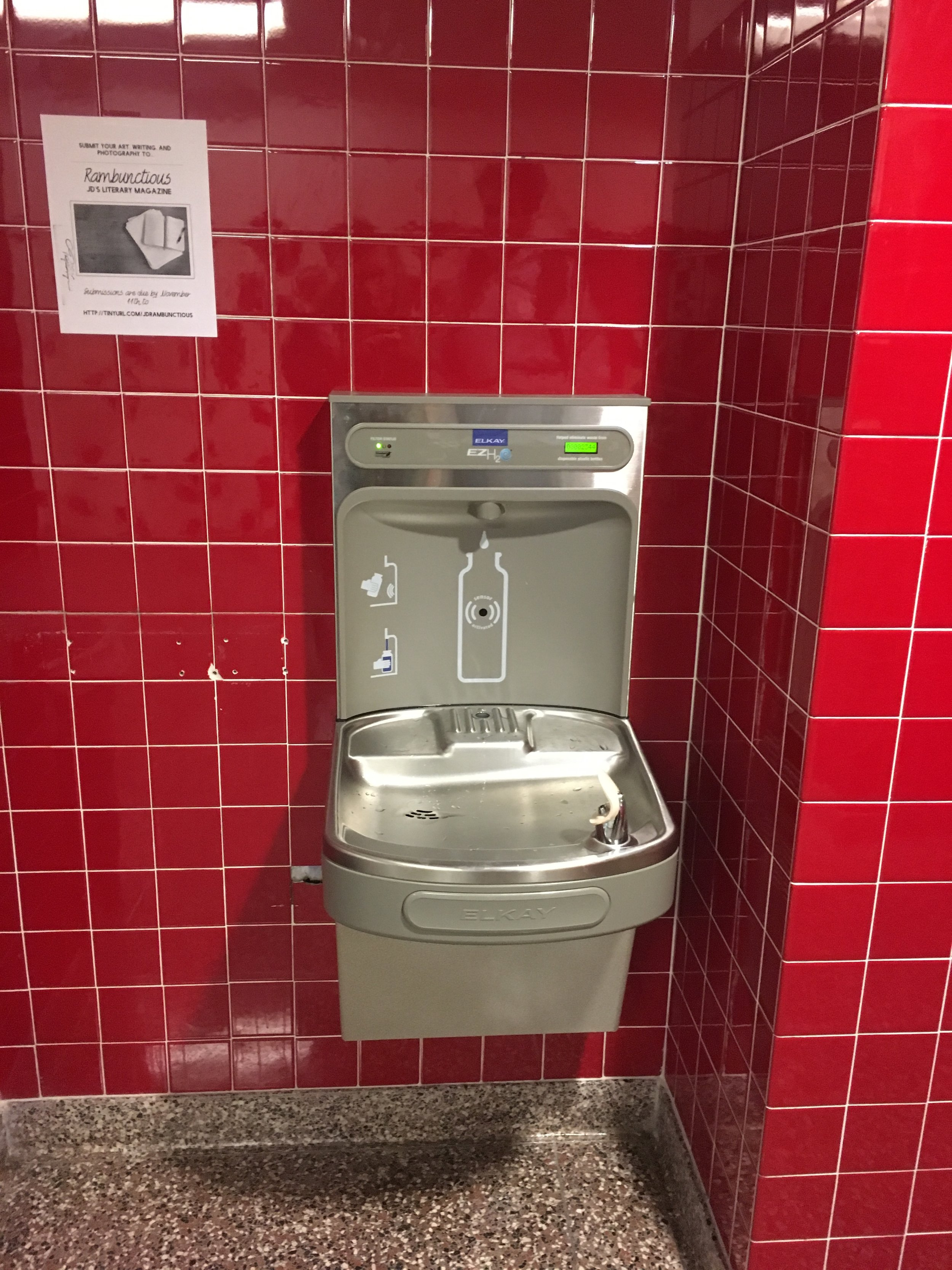 The new and improved Red Hall water fountain shows new water saving technology, but there are small holes in the wall to the left of the fountain.