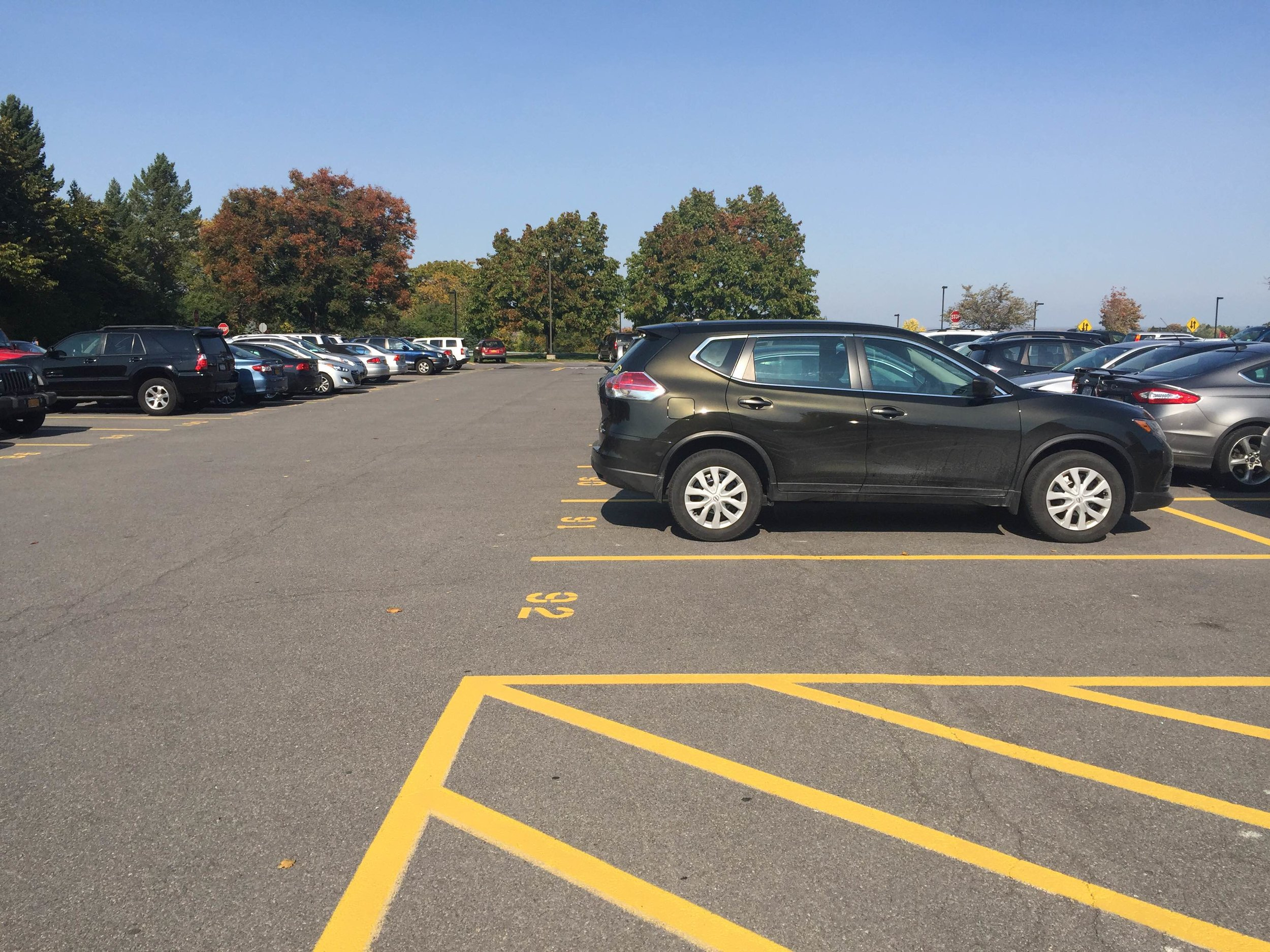 Each parking spot in the senior parking lot has a number (as pictured above) that corresponds to the number on the parking pass of a student.