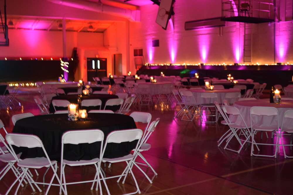 Last year's junior prom had a simple black and white theme. How will this year's Hawaiian theme transform the auxiliary gym?