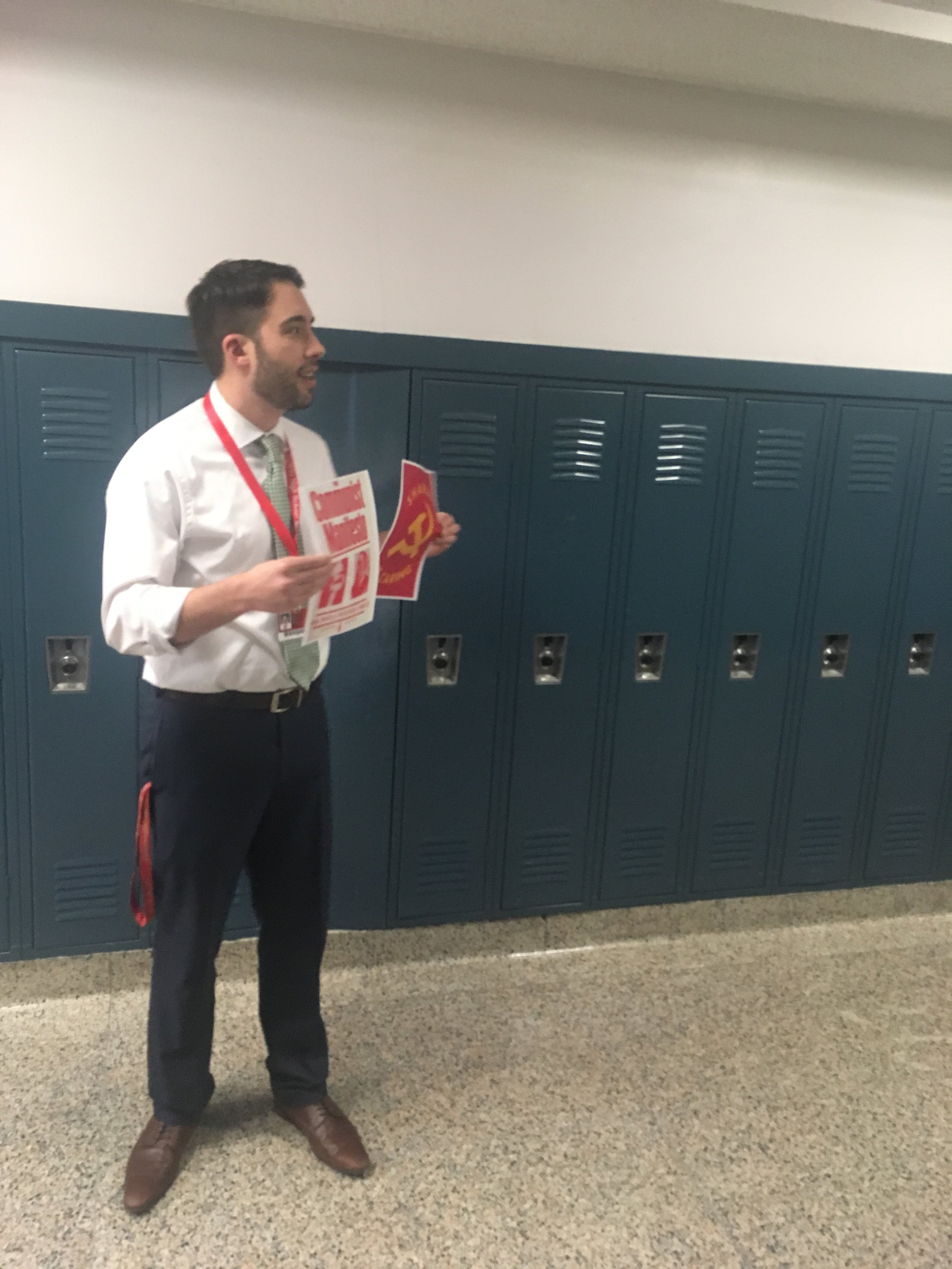 Mr. Berger attempts to gather student support for the Glorious Revolution as blue hall classes dismiss for 4th period lunch.