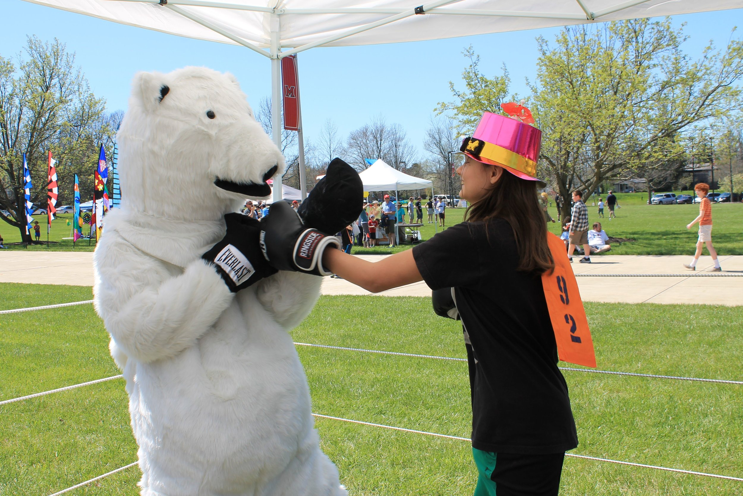 Christopher, our bear, was such a sport to be in that hot suit on a warm spring day, letting children punch him with surprising vigor.
