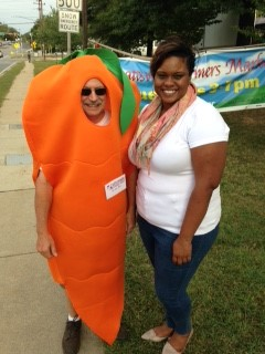 "Mayor Candace B. Hollingsworth and volunteer William Kenworthy aka ""Mr. Carr Ot"" at the Hyattsville Farmers Market."