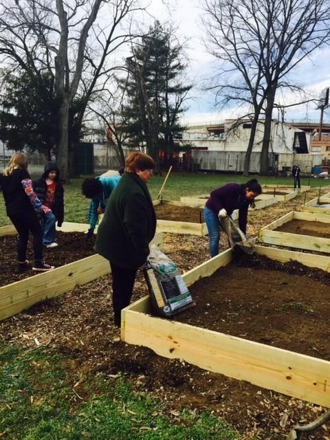 Edmonston residents preparing raised beds at the Edmonston Community Garden.