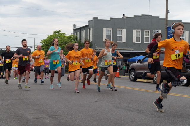 Participants running in the Crewe Homecoming Festival 5K run organized by the local volunteer fire department.
