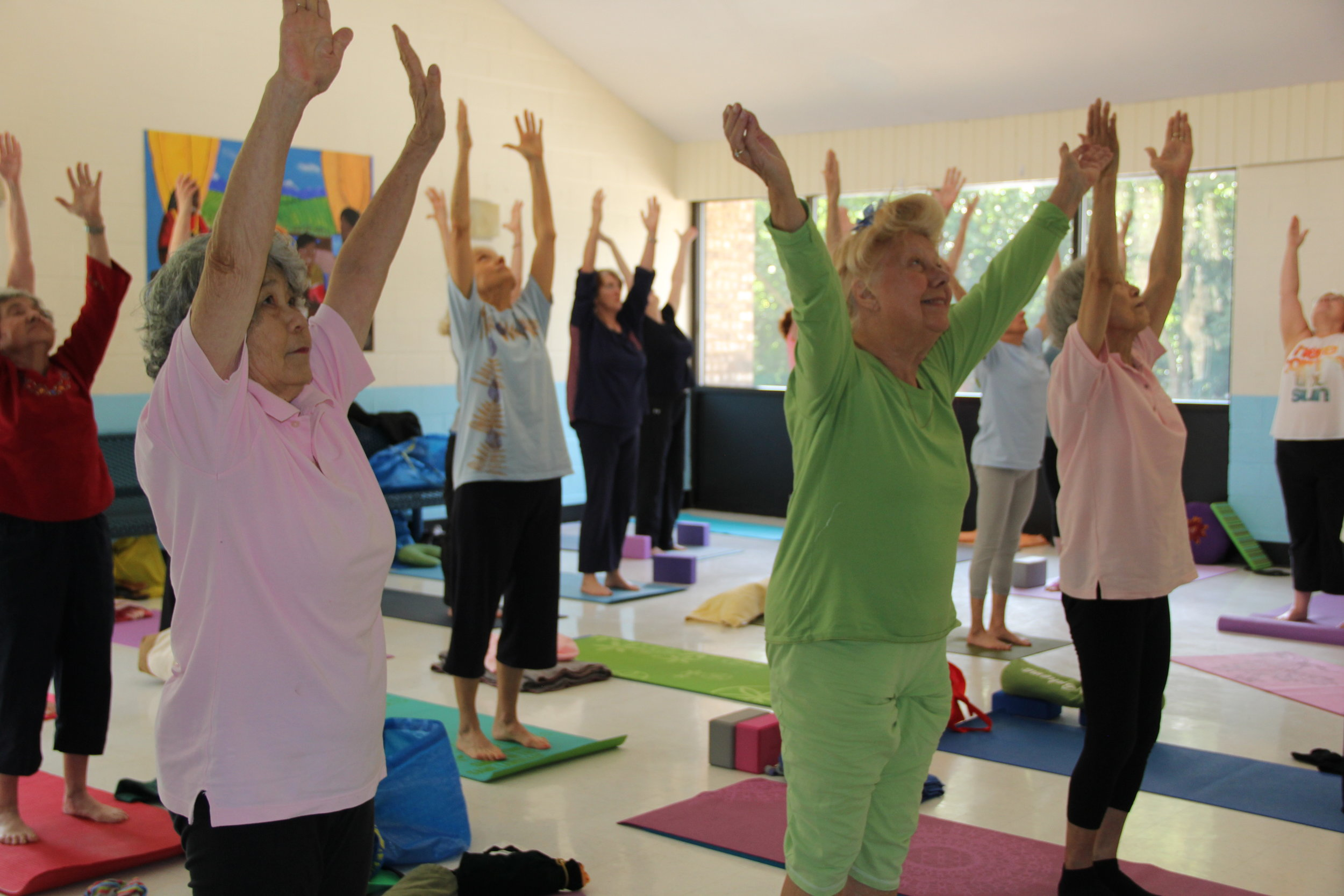 Yogis practicing at one of the Greenbelt Recreation Department's regular afternoon yoga classes for older adults at the Springhill Lake Recreation Center.