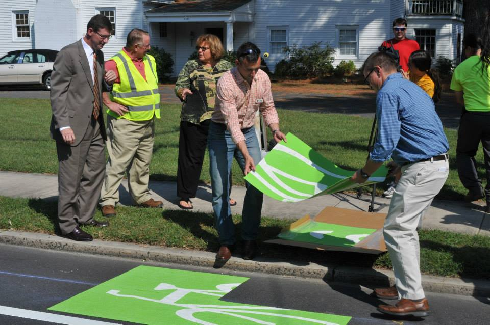 Salisbury residents help install bike lanes and signs to improve bike safety along city roads.