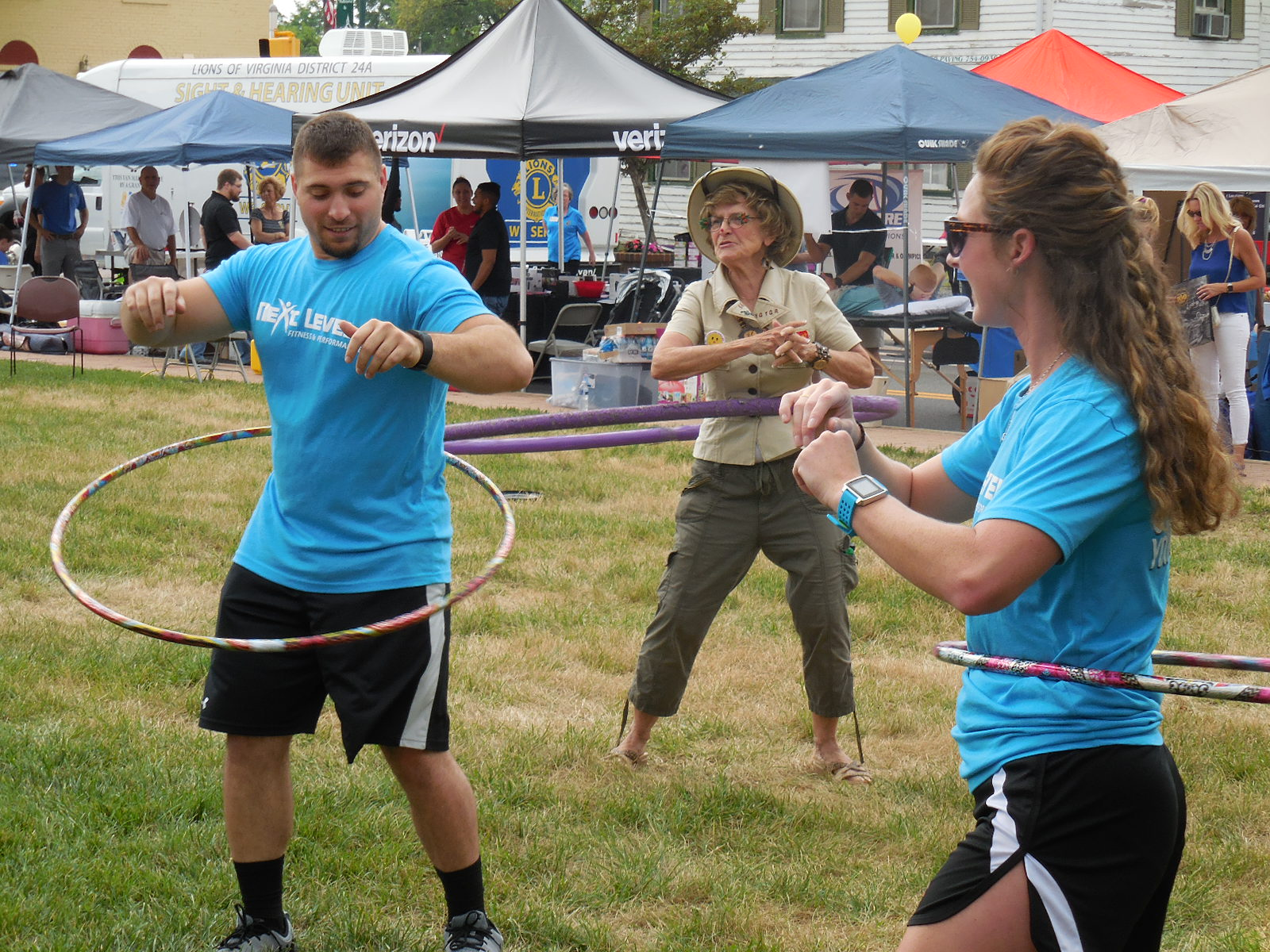 Residents enjoying outdoor activities at the Town's annual Health and Fitness Day Town Event.