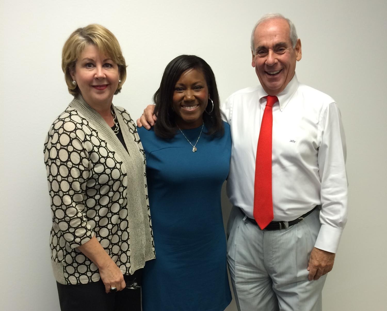 Cheri Fama (JDR President/COO), Aisha Crumbine and John Daugherty (JDR Chairman/CEO and Founder)