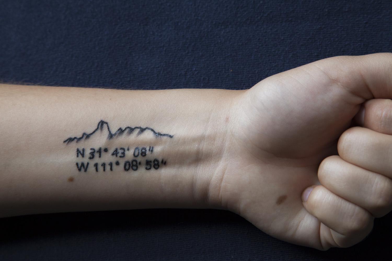 Tattoo #3, 2012 - Tattoo depicting Bavoquibari Mountain and GPS coordinates