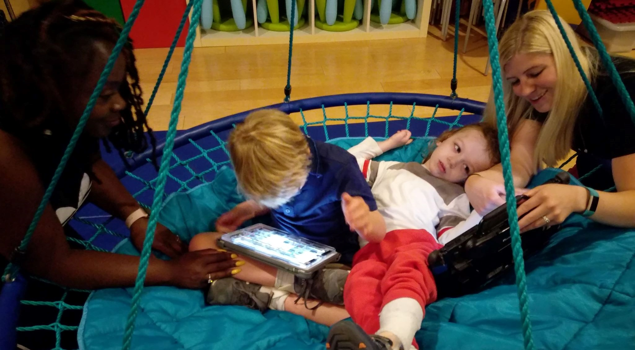 Jack and Taylor in Swing Using Devices.jpg