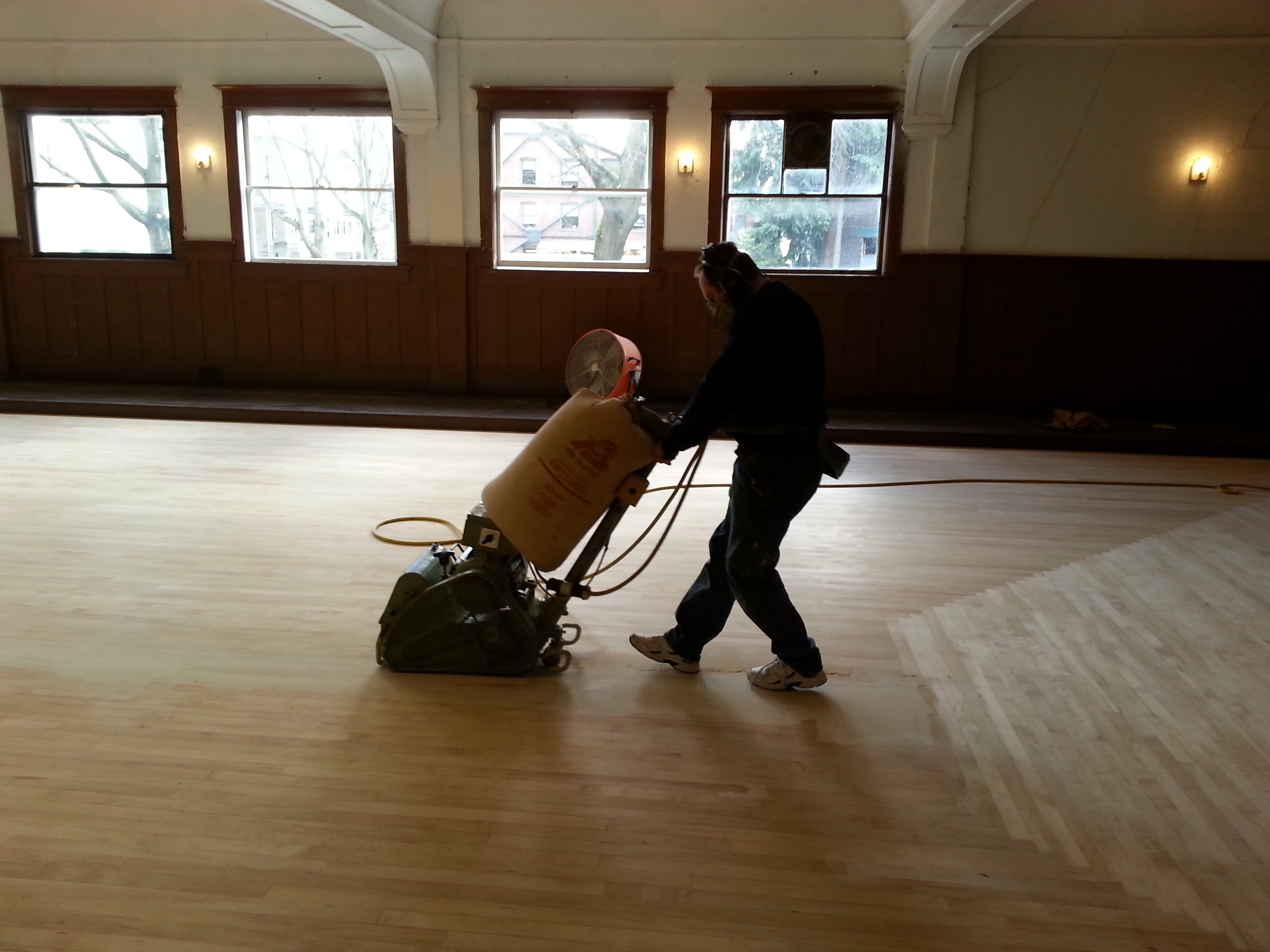 Marian running the sanding machine