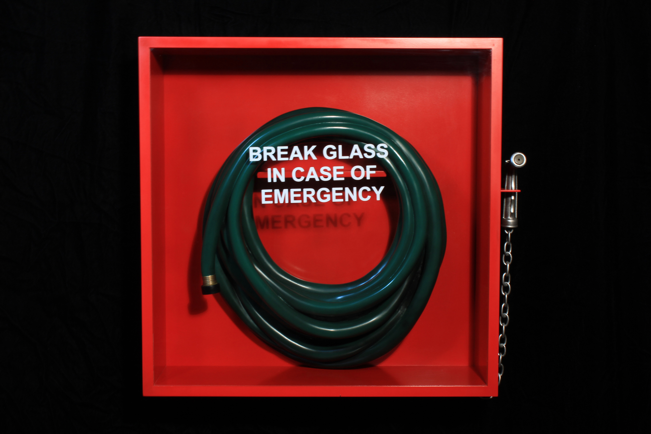 "Break Glass in case of Emergency, 2015. 25"" x 27"" x 6"". Basswood, Poplar, Walnut, glass, vinyl."