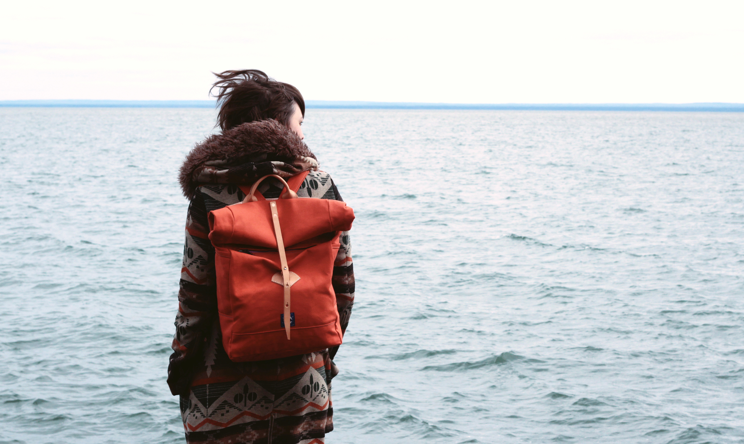 Afton backpack in Terra Cotta Orange. Photo by Amy Black.