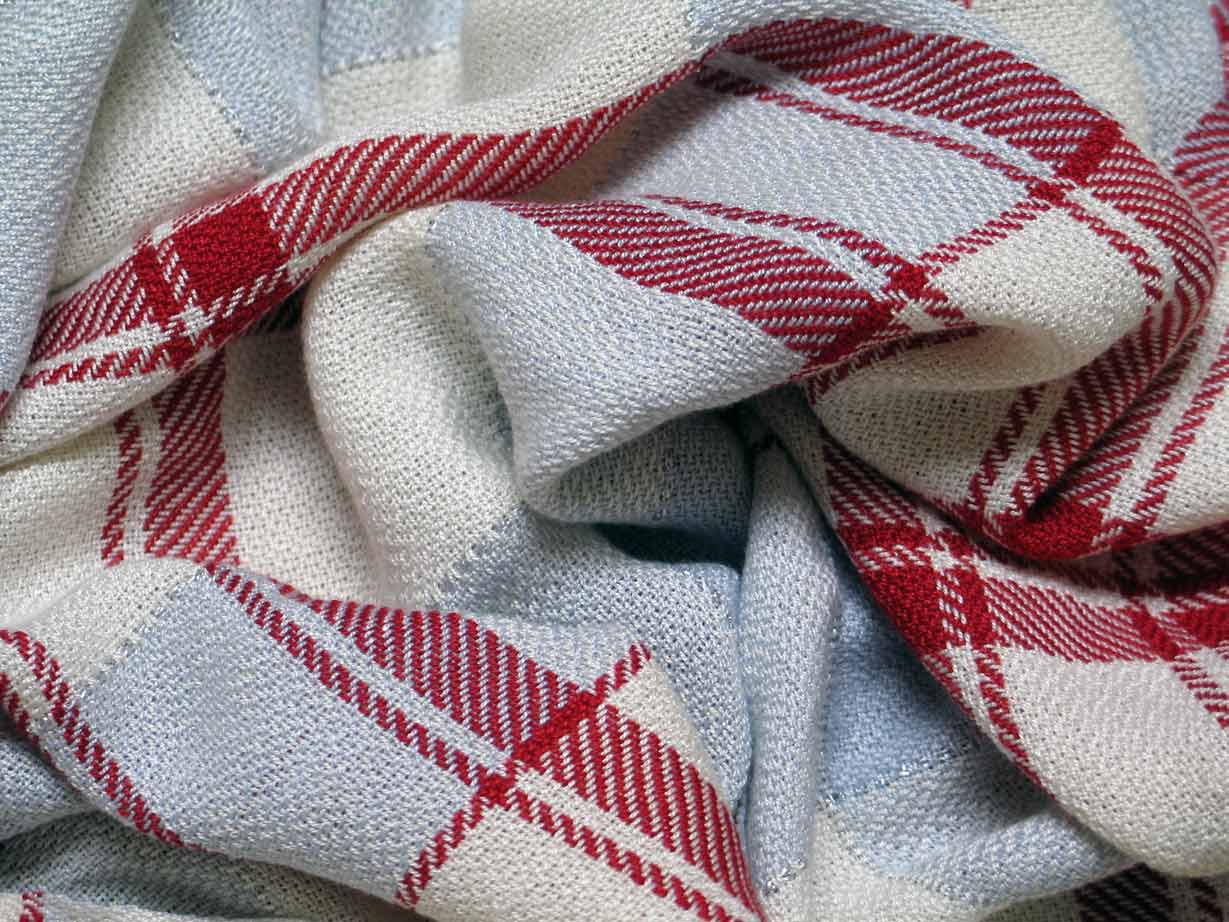Handwoven tencel scarf by Marty Pomeroy. Used on all Contact pages.