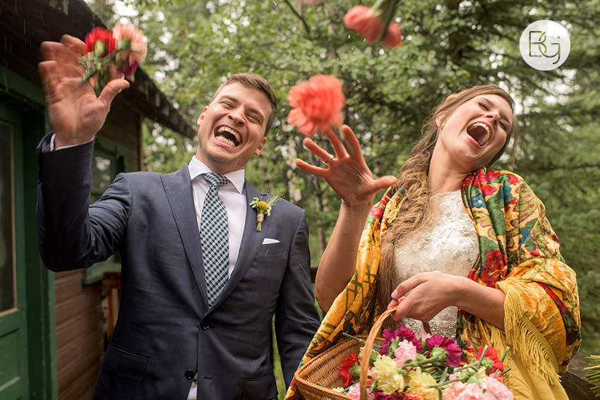 funny wedding photo canmore wedding photographers bride throwing flowers