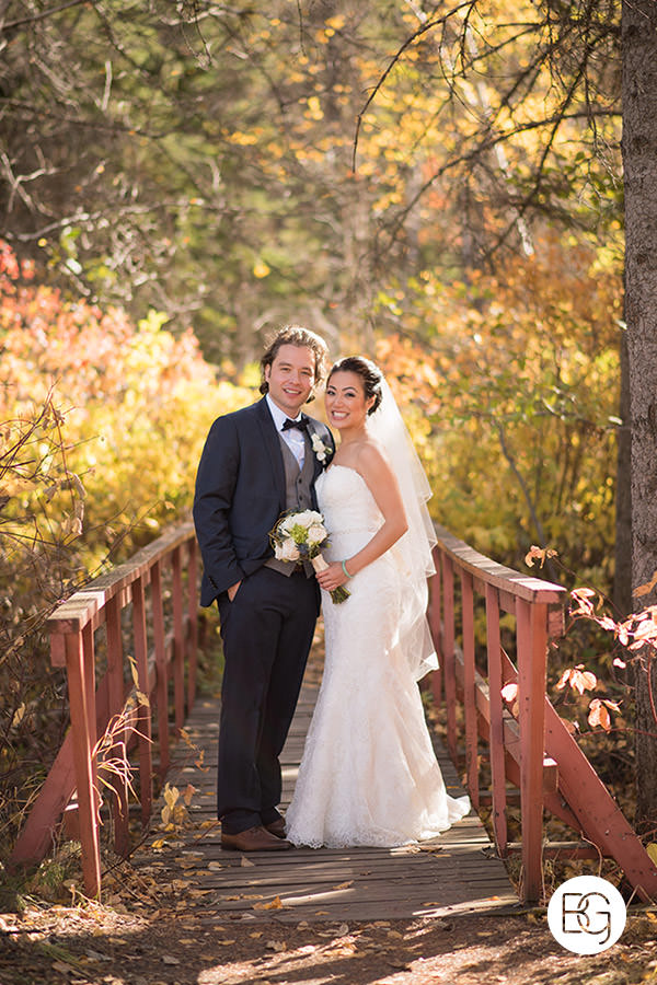 autumn wedding portrait in Edmonton river valley leaves bridge