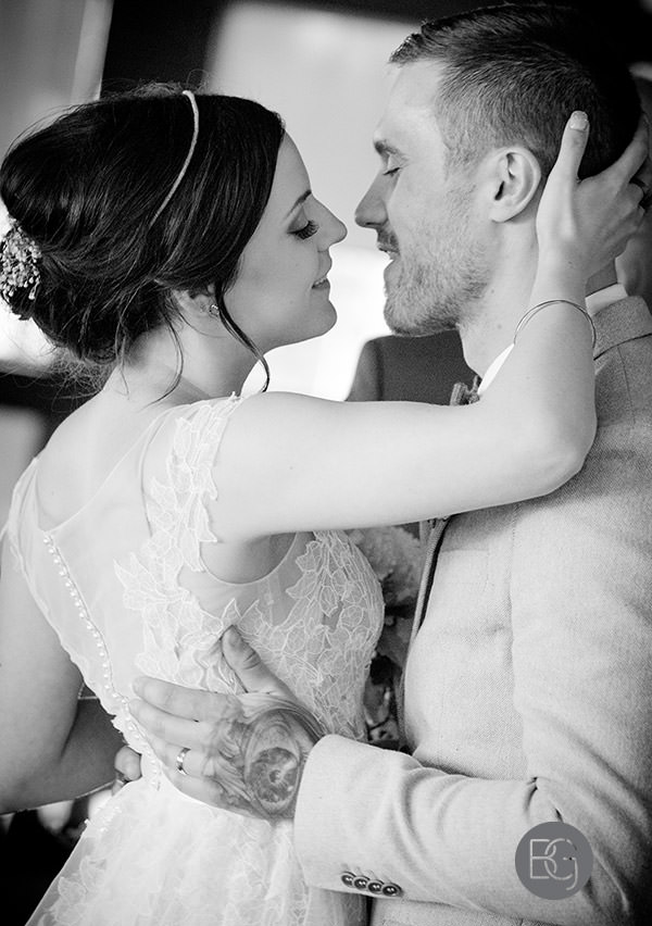 wedding first kiss romantic black and white