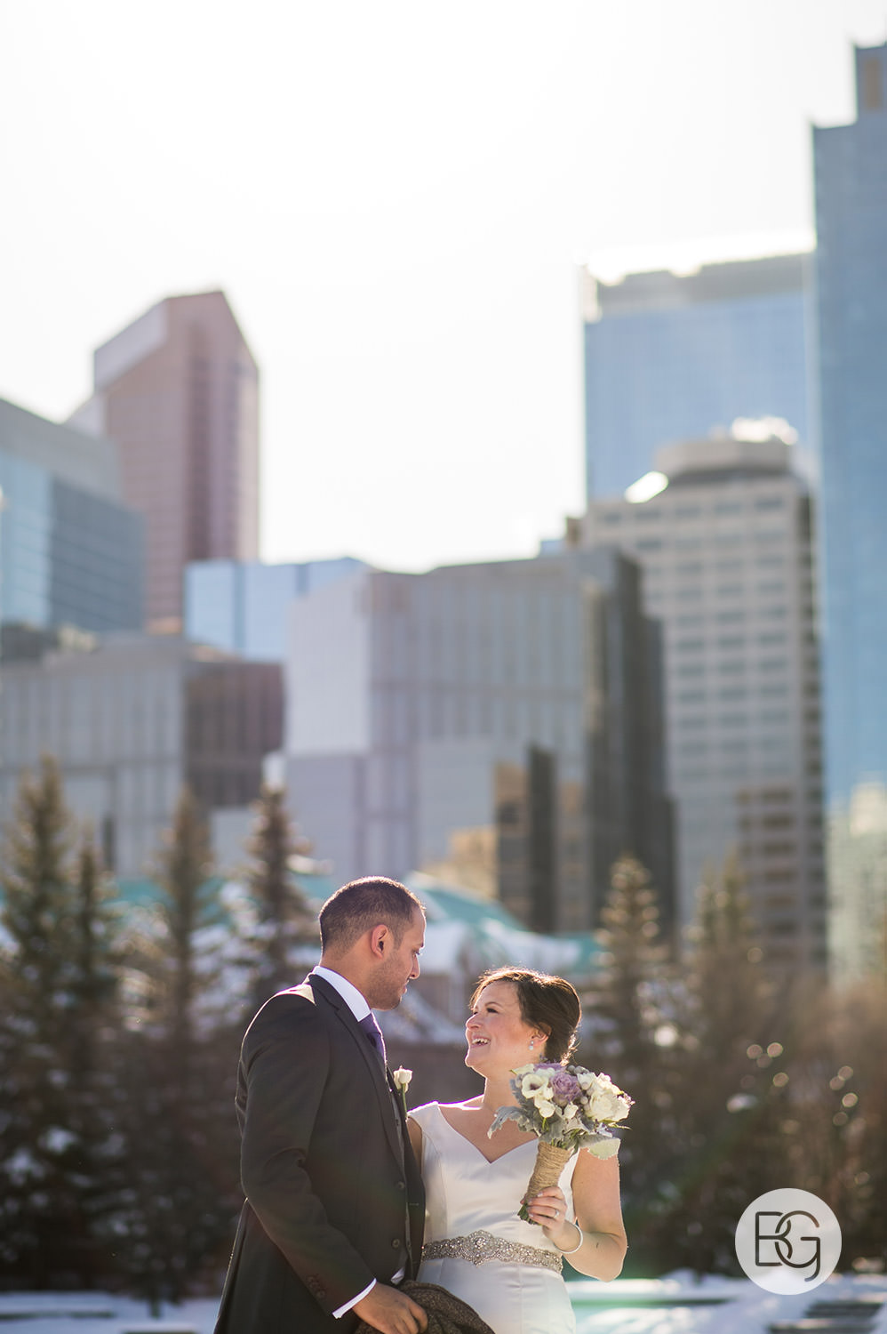 winter wedding in calgary at river cafe in princes island park city skyline