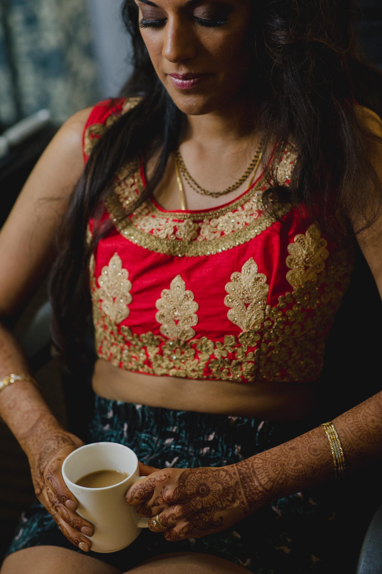 hindu bride getting ready for reception venue