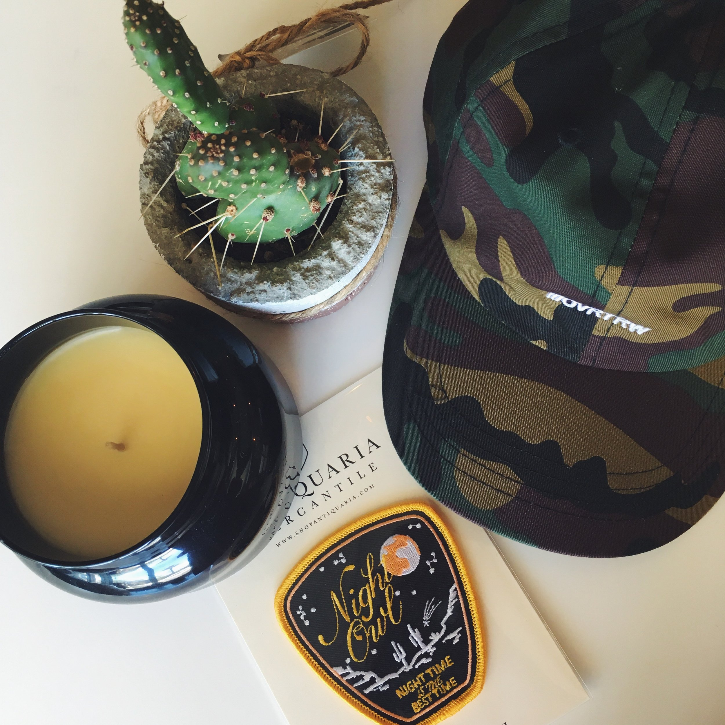 Above: Volcano Candle ($22-$32),  Night Owl Patch ,  INDY Hat