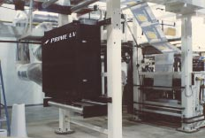 PRIME UV Wide-web Multi-lamp UV Processor installed on a W&H Astroflex Press curing UV coatings on the CI Flexo Coater on Multiwall bags.