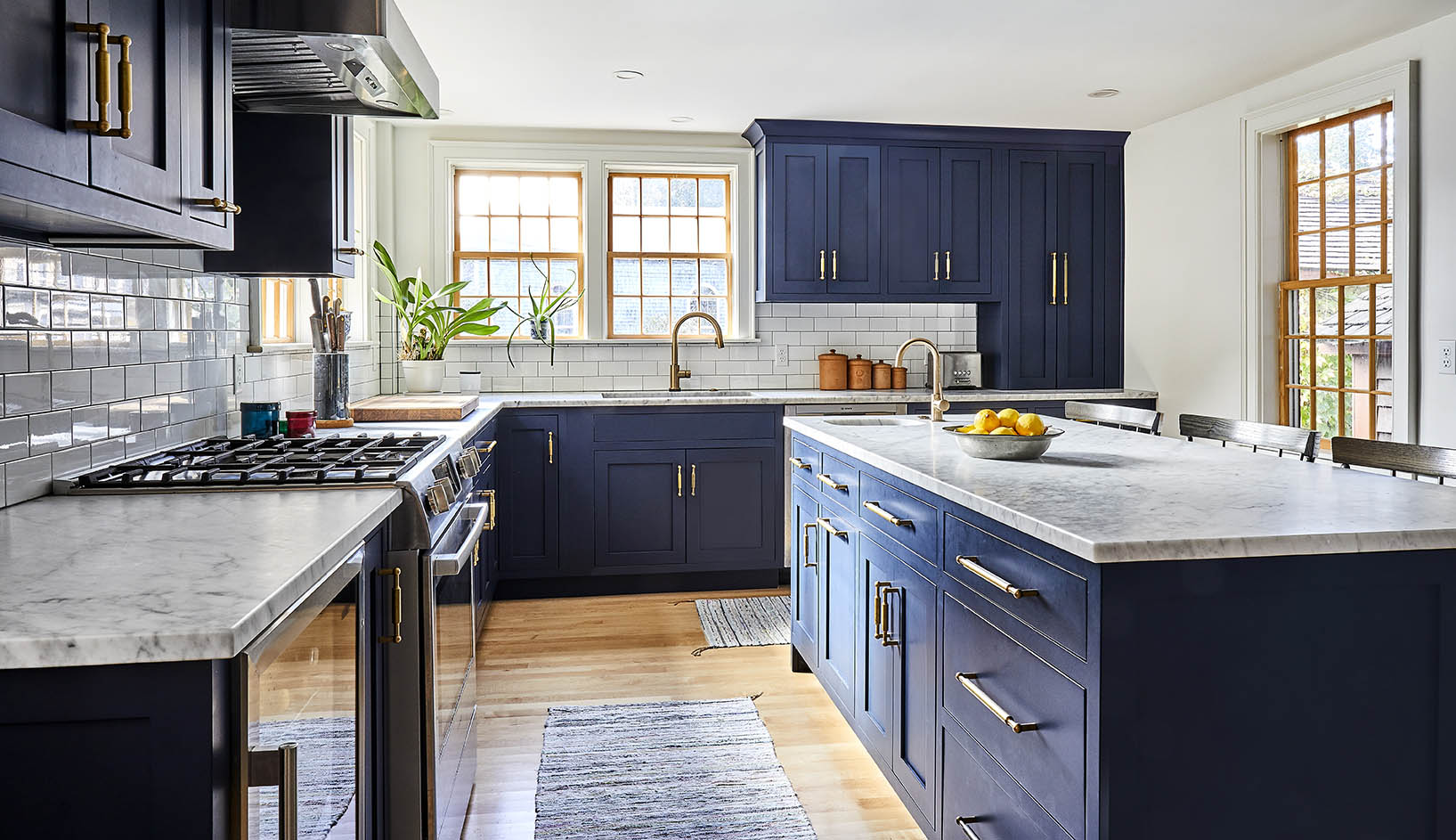 O&G Owner and Creative Director Jonathan Glatt's kitchen featuring Atlantic Hardware in Tumbled.  The kitchen has windows on three sides and is built within a 1790.  Just steps from Narragansett Bay, the house was built in 1760.  Natural finish wood windows and deep beaded window trim  all relate to the homes original character.