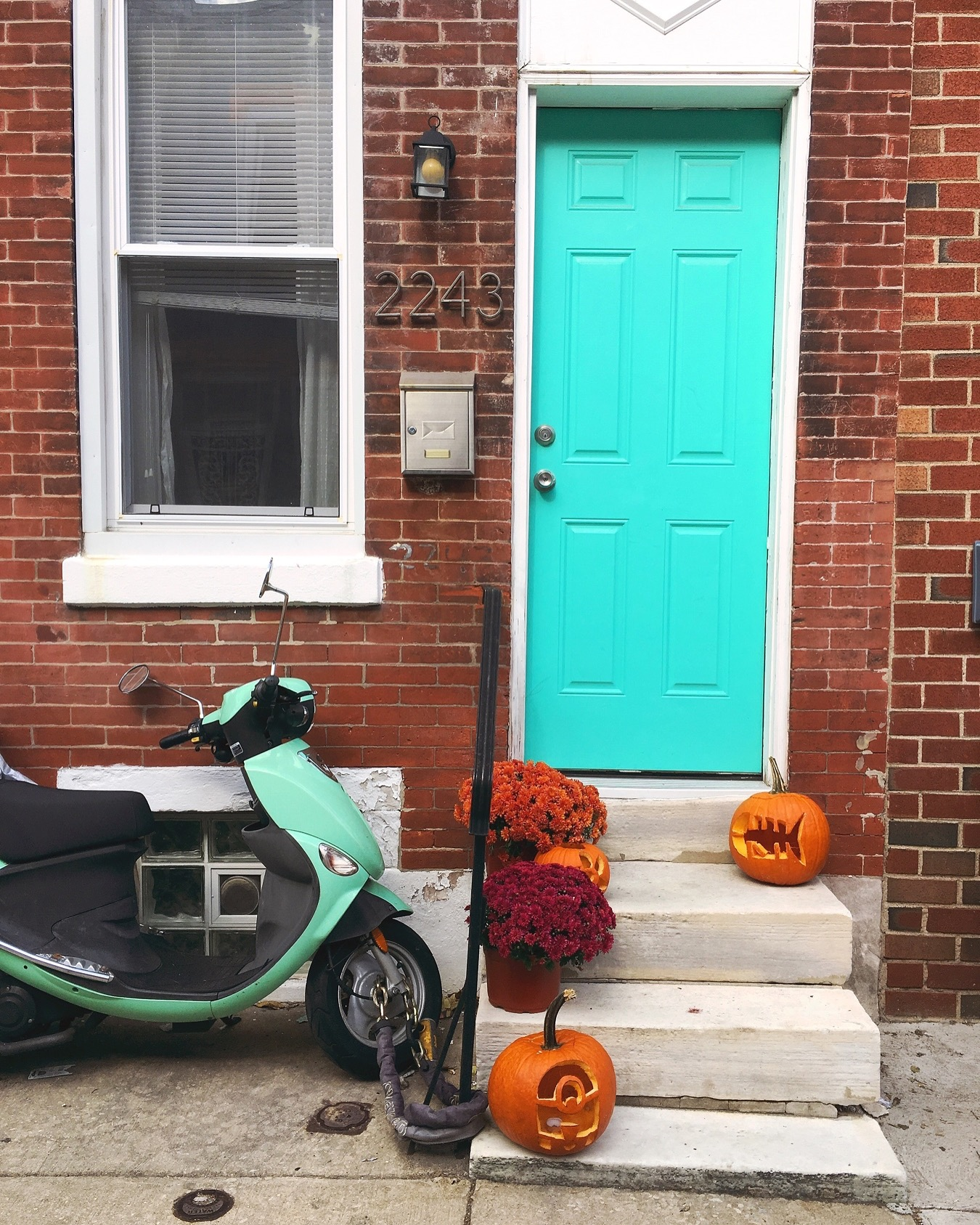 Teal door with pumpkins via Unusually Lovely