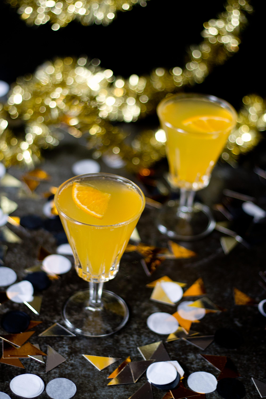 Tangerine Elderflower Spritz via Unusually Lovely