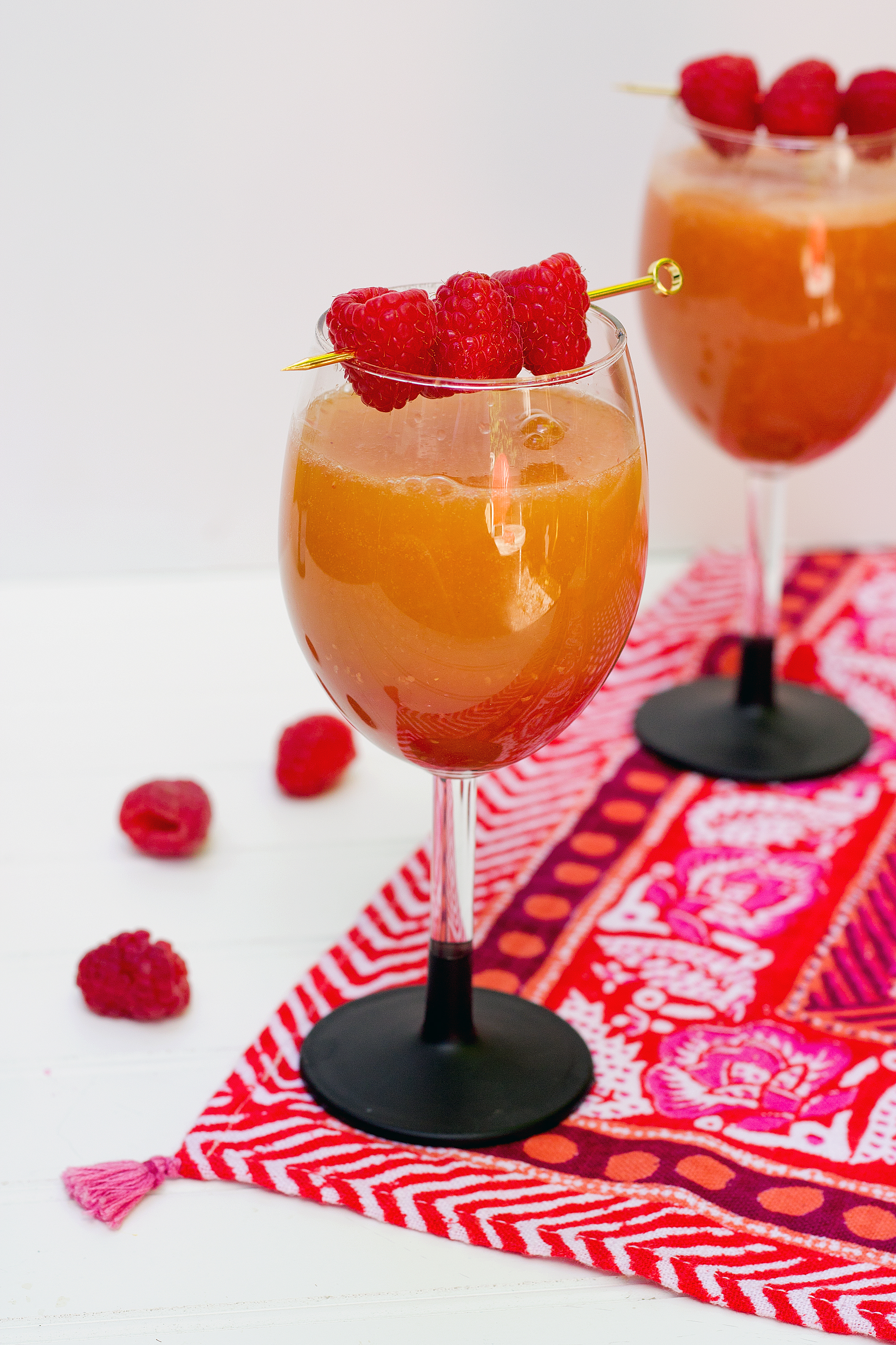Get the recipe for this Raspberry and Peach Bellini from Unusuallylovely.com