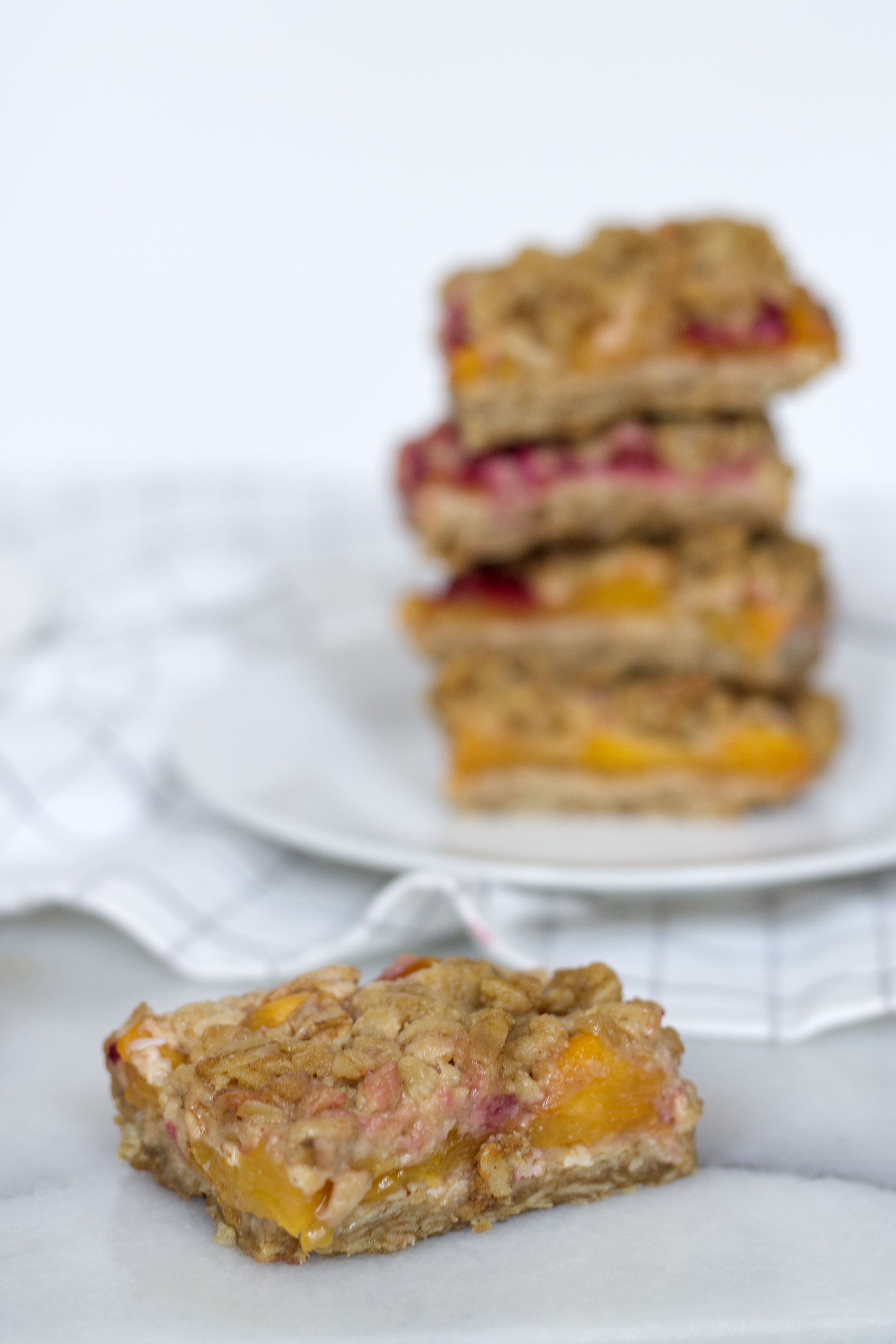 Fruit bars with peaches and raspberries via UnusuallyLovely.com