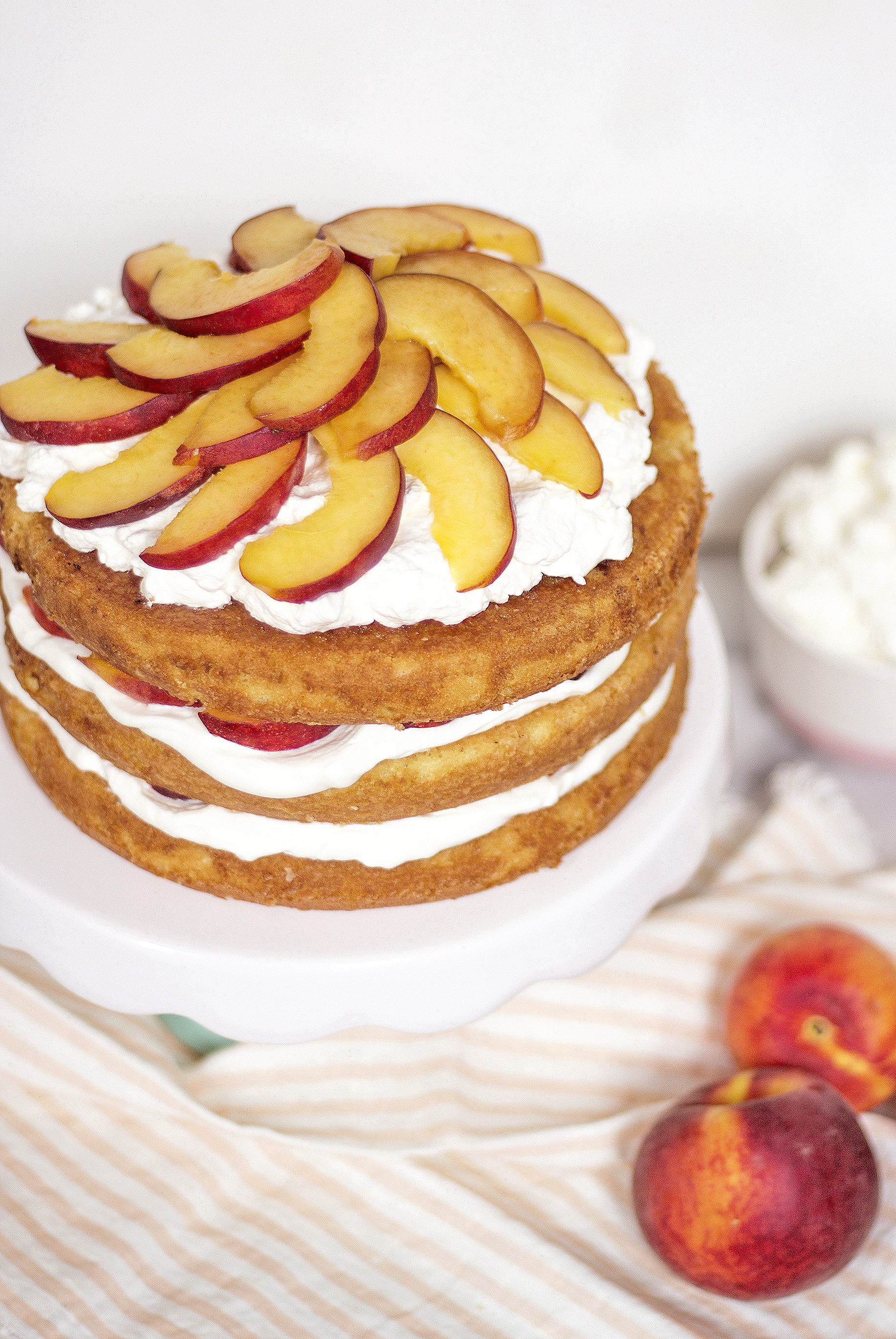 peach shortcake with homemade whipped cream and fresh peaches