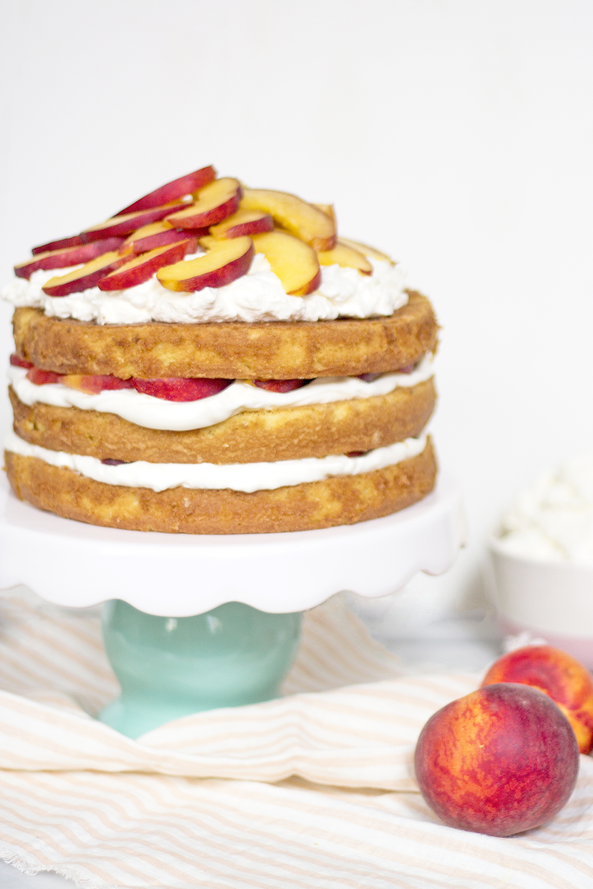 A shortcake filled with homemade whipped cream and fresh peaches. Perfect for summer! Get the recipe: Unusuallylovely.com