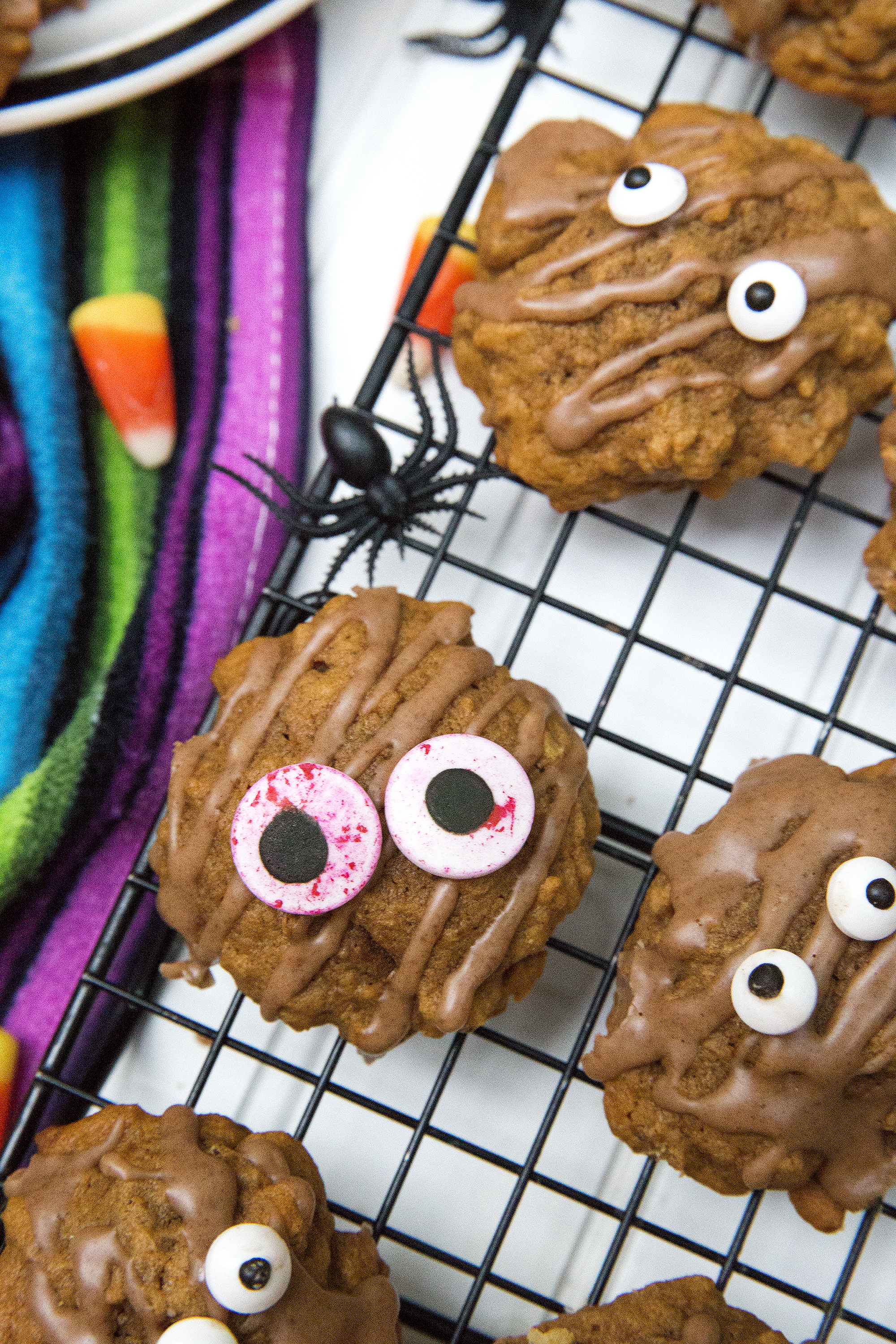 Pumpkin Cookies topped with Spooky Monster Eyes. Get the recipe: UnusuallyLovely.com