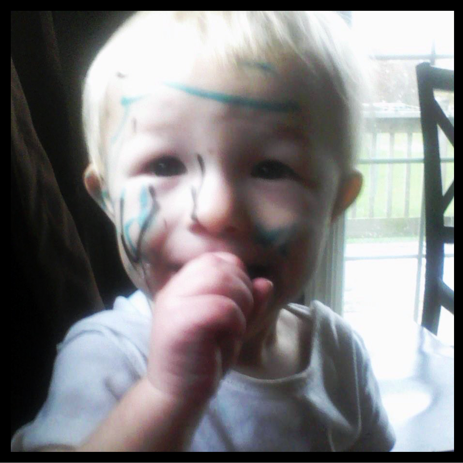 """2 year old Johnny and his sister had just come from a festival where they saw children having their faces painted. Johnny's sister decided to join in on the fun...and """"painted"""" her brother's face with permanent marker."""