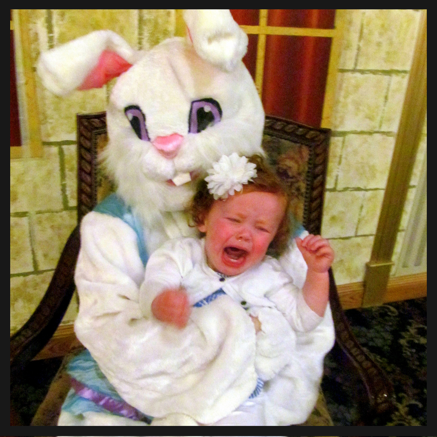 """Brynn """"enjoying"""" her first trip to see the Easter bunny..."""