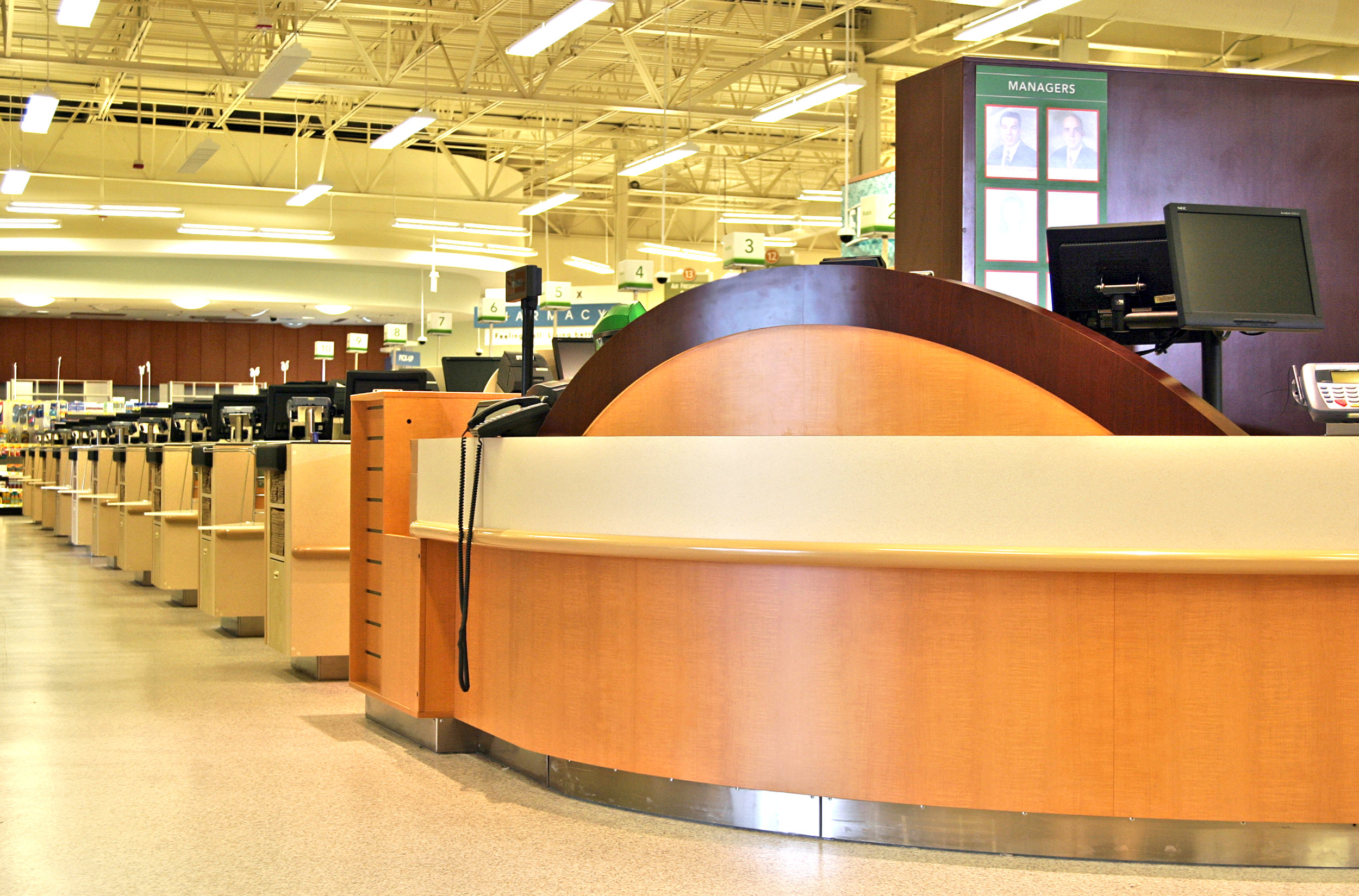 Bumpers on a customer service counter and checkstands.