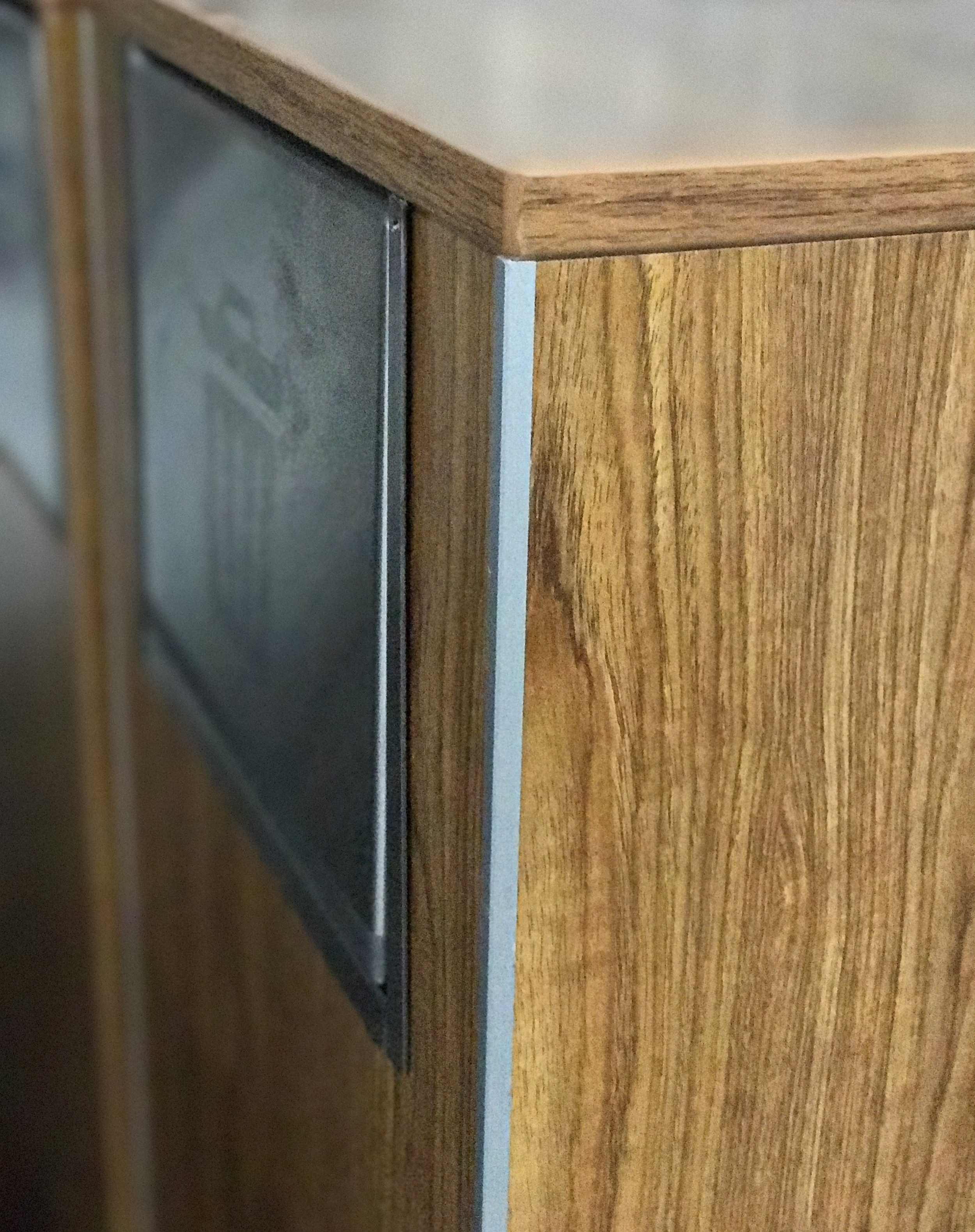 EMI's aluminum corner trim, installed on a trash bin.