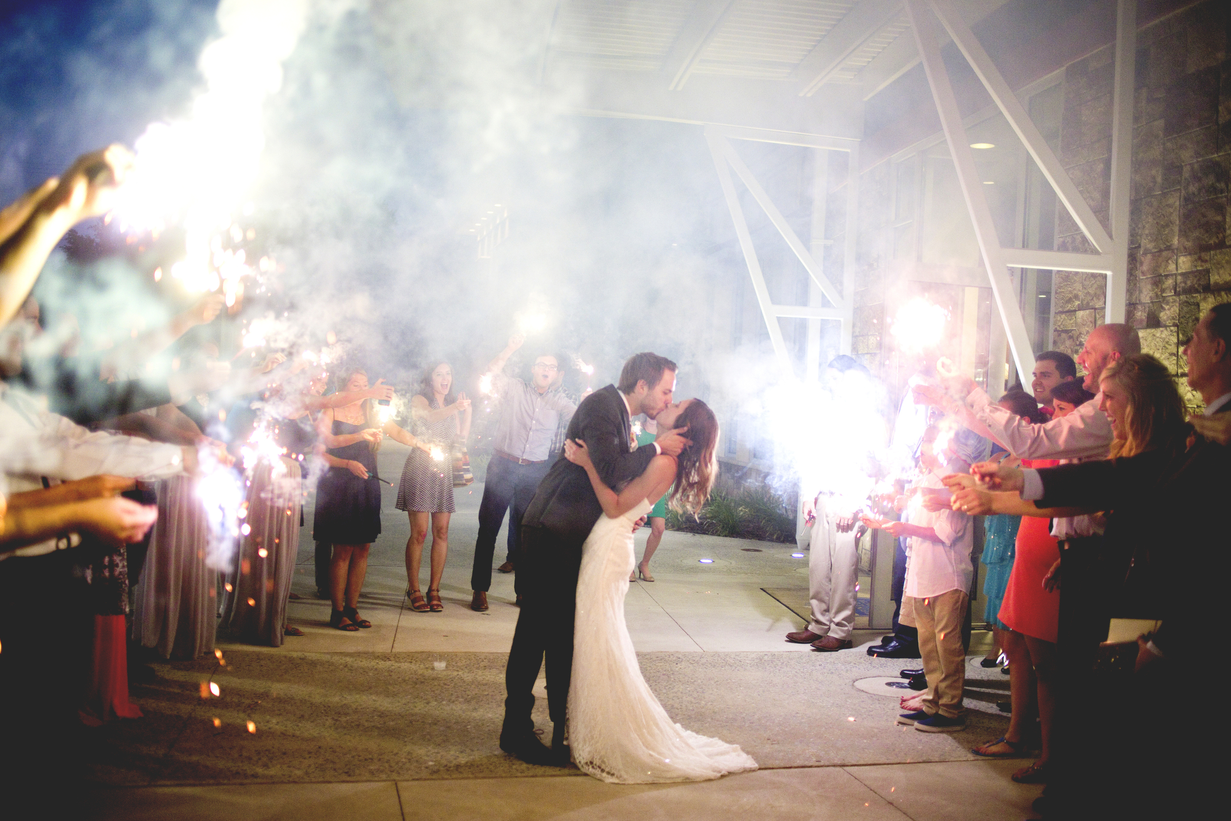 Yes- I do ask all of my couples to pause for a kiss in the sparklers! Who wouldn't want a photo like this?