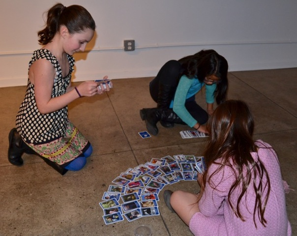 Young girls playing with WINGS trading cards