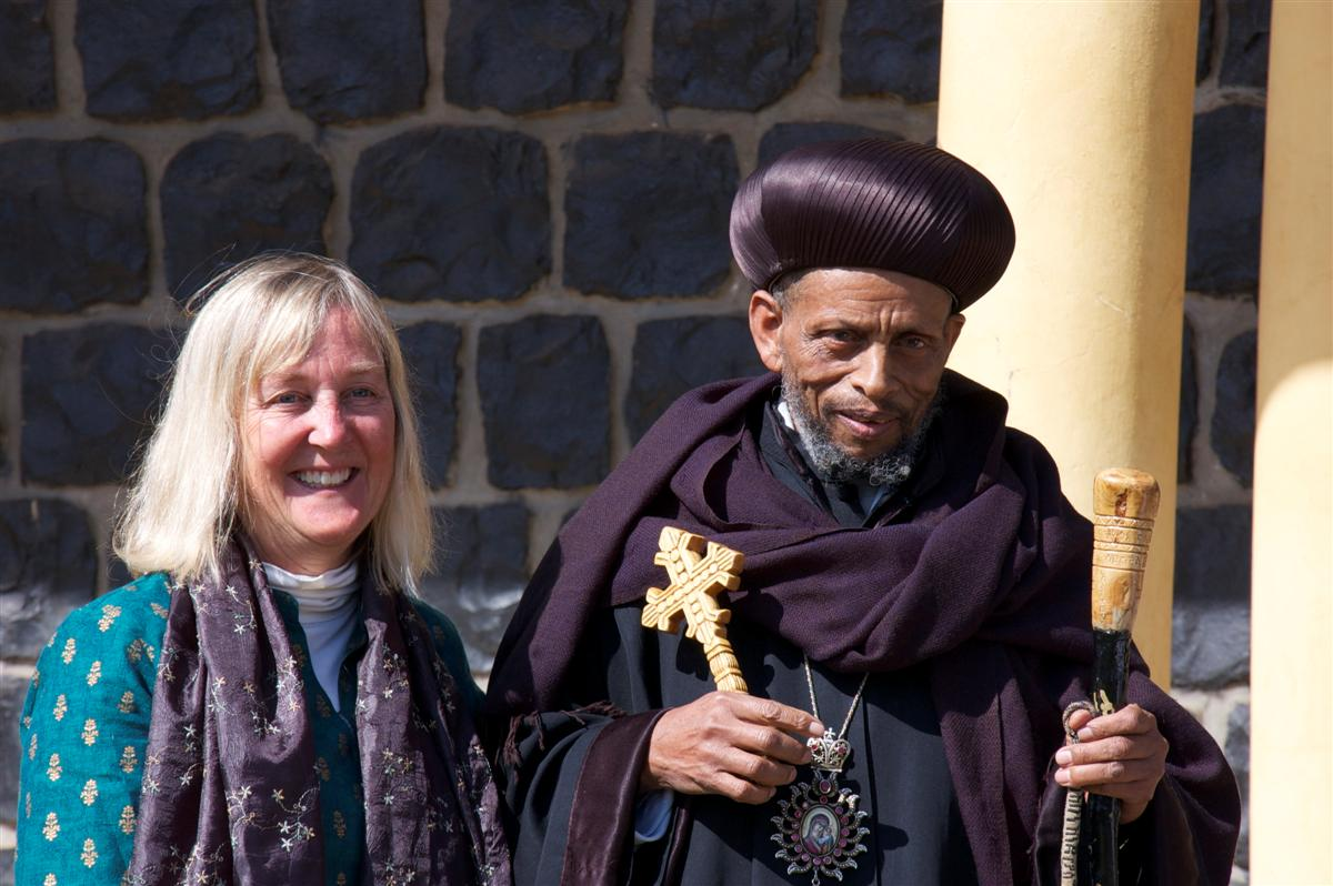 Canopy Meg stands with a Coptic Priest in Ethiopia. Photo by Lyndia Ball.