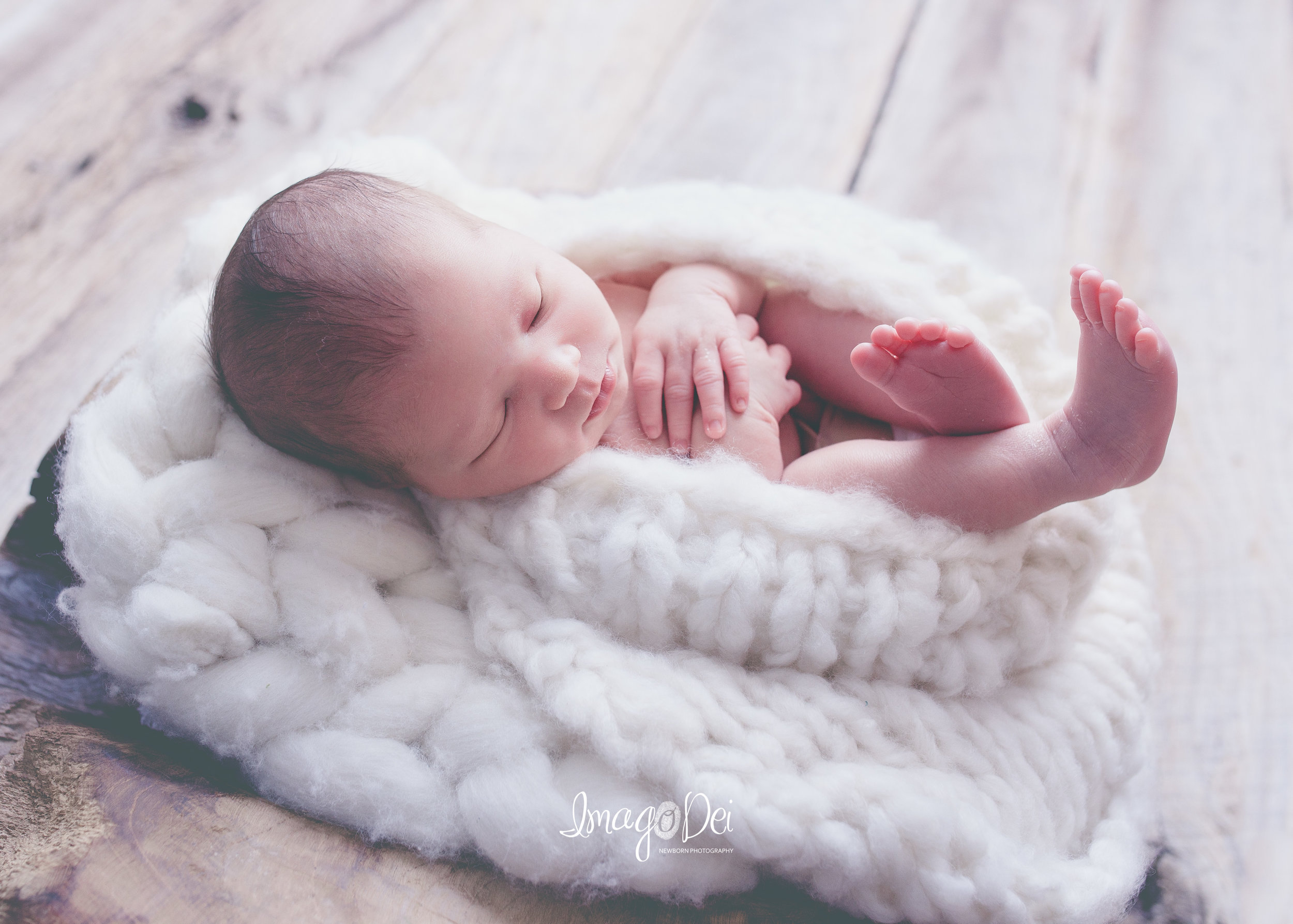 "- ""Most amazing and cherished newborn photos of my son! Crystal takes time to get perfection!""-Darla P"