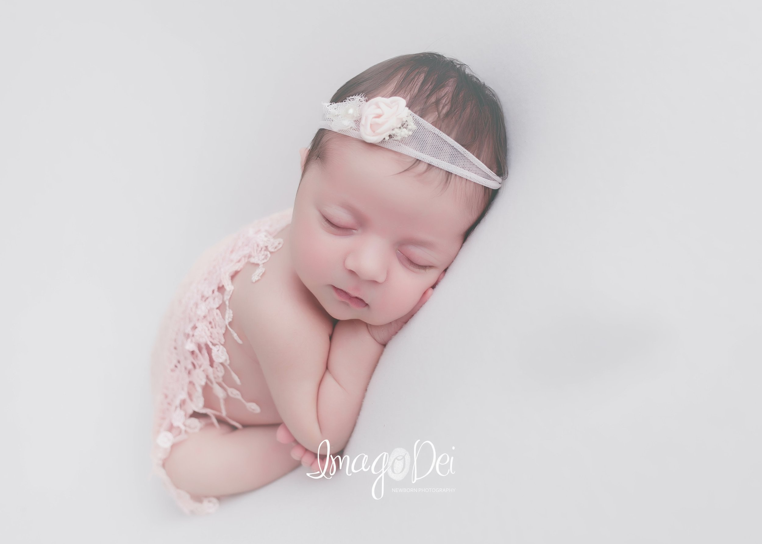 "- ""Crystal created nothing short of a picture-perfect photo session. She cared for our sweet lil girl with the utmost of love while making the whole session easy on us and a true delight. The resultant photos were inexplicably perfect and timeless; exactly what we wanted! Can't recommend anyone better for an adorable newborn session!""-Amanda Z"